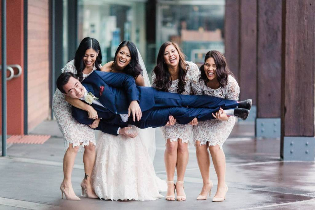 Bridal Party having fun on a drizzly day