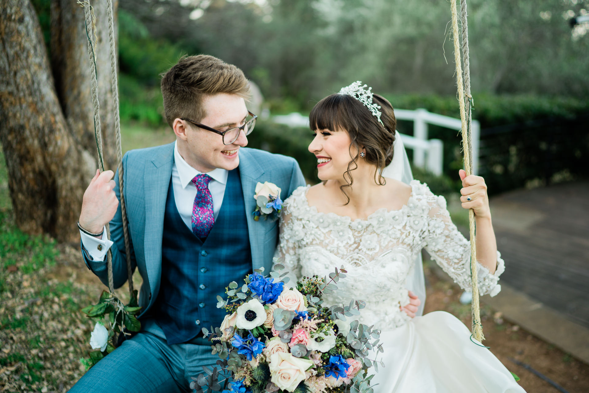 Bride and groom smiling on a swing - Fuzzy Pear Studio Blue Mountains Wedding Photography