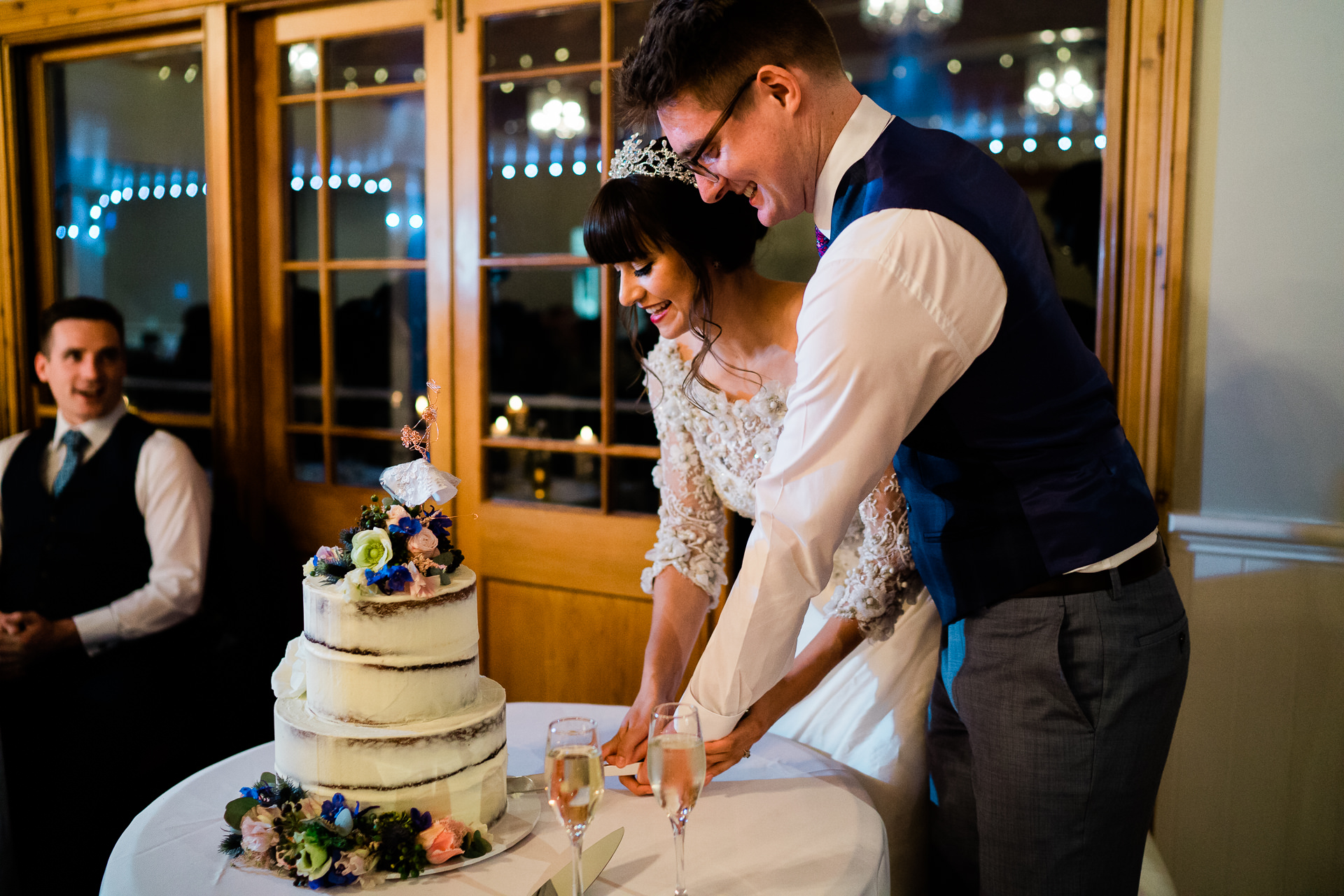 Bride and Groom cut the cake at the reception - Fuzzy Pear Studio Blue Mountains Wedding Photography